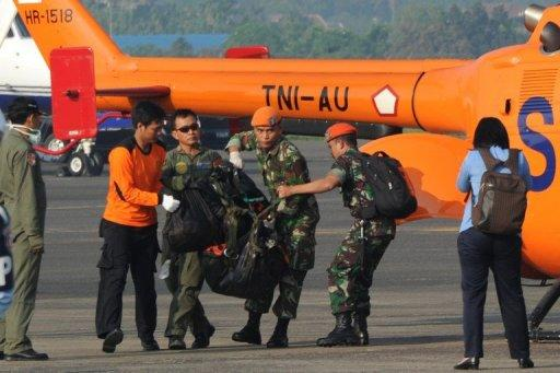 Soldiers carry a body bag containing the remains of passengers of the ill-fated Sukhoi plane crash, on arrival at Halim Perdanakusuma airport in Jakarta, on May 11. Rescuers said the bodies of those who perished when Sukhoi's new Superjet 100 hit Mount Salak in western Java on Wednesday, killing all on board, were badly dismembered
