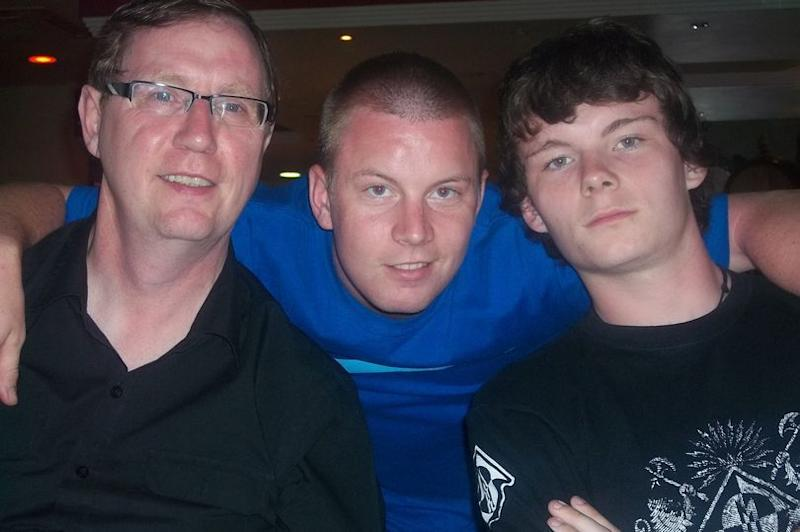Ryan Myers, centre, with his dad John, left, and brother Michael, right. Photo: Handout / Myers family