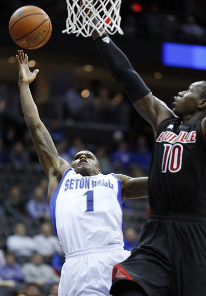 Seton Hall guard Aaron Cosby (1) shoots against Louisville center Gorgui Dieng (10) during the second half of an NCAA college basketball game on Wednesday, Jan. 9, 2013, in Newark, N.J. Louisville won 73-58. (AP Photo/Julio Cortez)