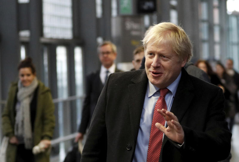 Britain's Prime Minister Boris Johnson arrives on the platform to board a train in London, Friday Dec. 6, 2019, on the campaign trail ahead of the general election on Dec. 12. Johnson pushed for the December vote, which is taking place more than two years early, in hopes of winning a majority and breaking Britain's political impasse over Brexit. (Peter Nicholls/Pool via AP)