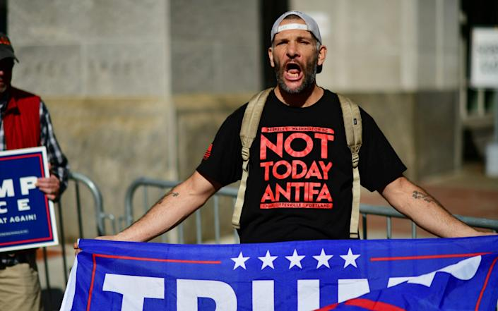 A Trump supporter screams at activists dancing in celebration after Democratic presidential nominee Joe Biden overtook President Donald Trump in Pennsylvania - MARK MAKELA /REUTERS