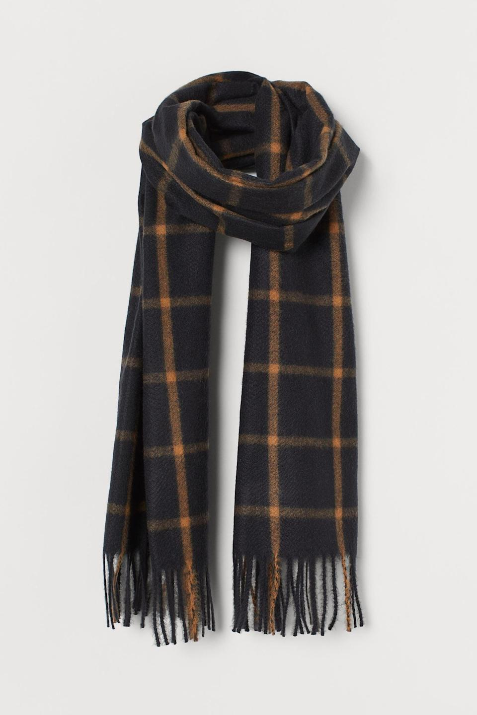 <p>This <span>Checked Scarf</span> ($18) will come with you on every trip.</p>