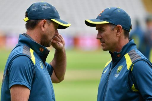 Tough call - Australia coach Justin Langer (R), pictured talking to assistant Ricky Ponting, has opted to play Josh Hazlewood against England at Lord's