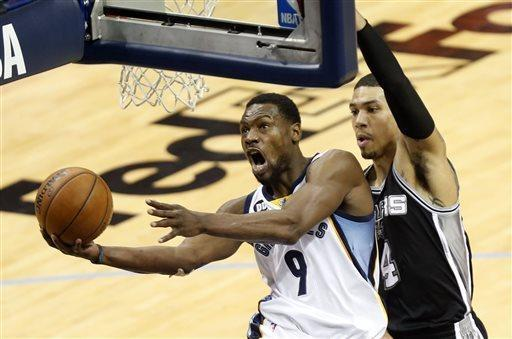 CORRECTS DAY - Memphis Grizzlies guard Tony Allen (9) drives to the basket as San Antonio Spurs guard Danny Green (4) defends during the half in Game 3 of the Western Conference finals NBA basketball playoff series, Saturday, May 25, 2013, in Memphis, Tenn. (AP Photo/Rogelio V. Solis)