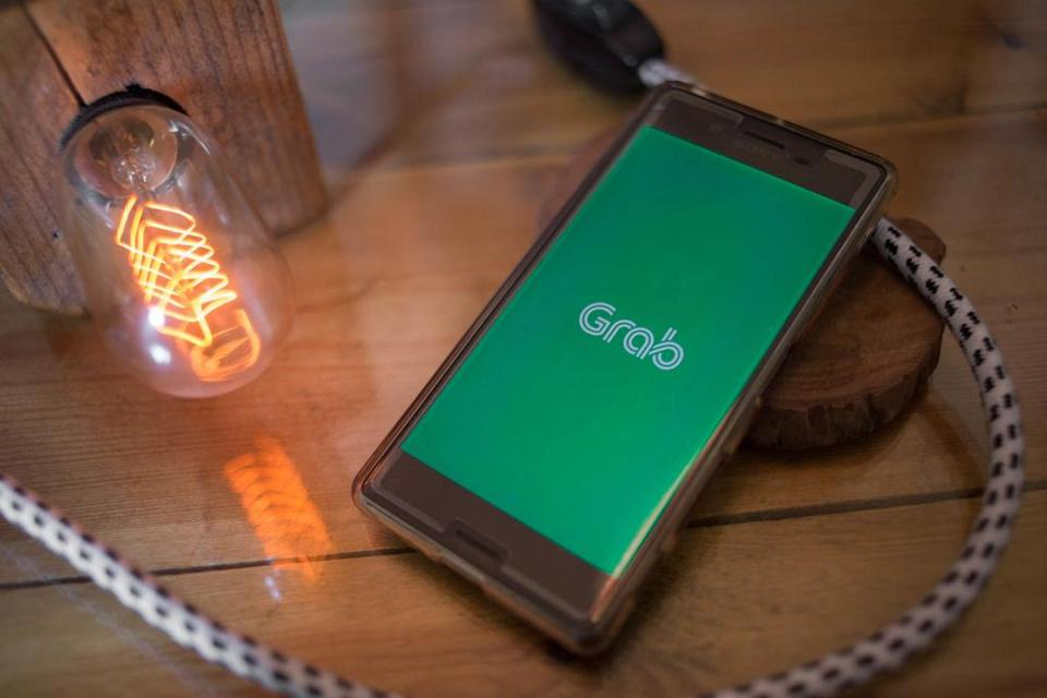 BANGKOK, THAILAND - 2018/07/20: In this photo illustration, the Grab application seen displayed on a Sony smartphone. (Photo Illustration by Guillaume Payen/SOPA Images/LightRocket via Getty Images)