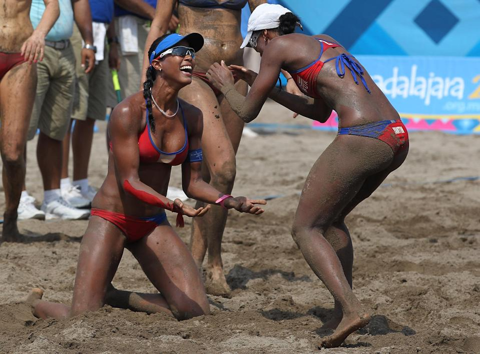 PUERTO VALLARTA, MEXICO - OCTOBER 21: Yarleen Santiago and Yamileska Yantin of Puerto Rico celebrate their Bronze Medal win against the USA at the Beach Volleyball Stadium on October 21, 2011 in Guadalajara, Mexico. (Photo by Al Bello/Getty Images)