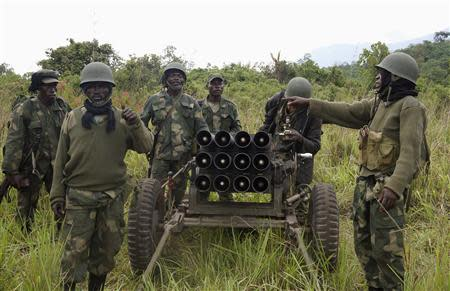 Congolese armed forces soldiers take position while battling M23 rebels in Kibumba