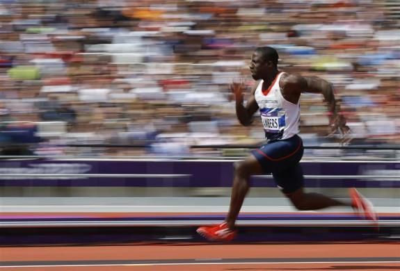 Britain's Dwain Chambers competes during round 1 of the men's 100m heats at the London 2012 Olympic Games at the Olympic Stadium August 4, 2012.