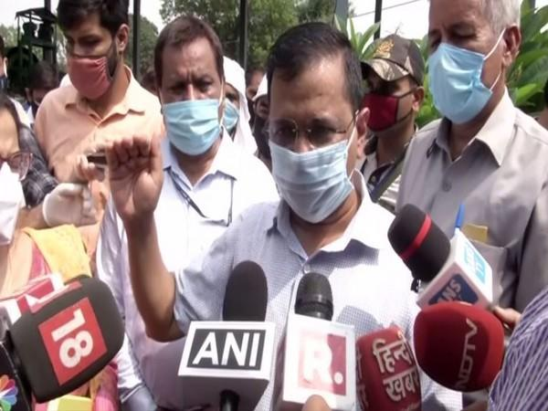 Delhi Chief Minister Arvind Kejriwal speaking to reporters on Thursday. (Photo/ANI)