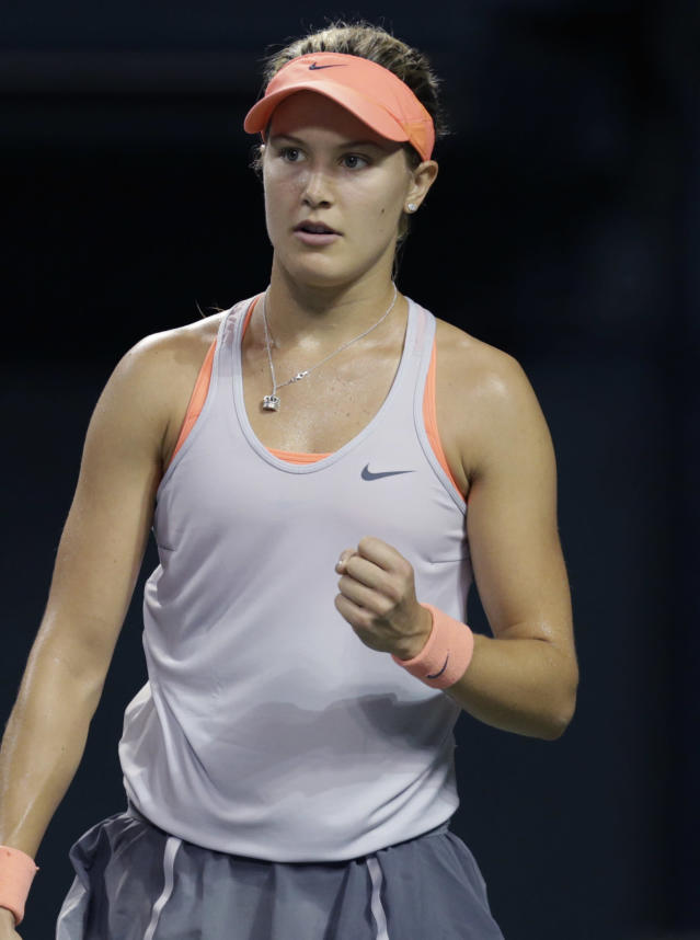 Eugenie Bouchard of Canada reacts after getting a point against Serbia's Jelena Jankovic during their third round match of the Pan Pacific Open tennis tournament in Tokyo, Wednesday, Sept. 25, 2013. (AP Photo/Shizuo Kambayashi)