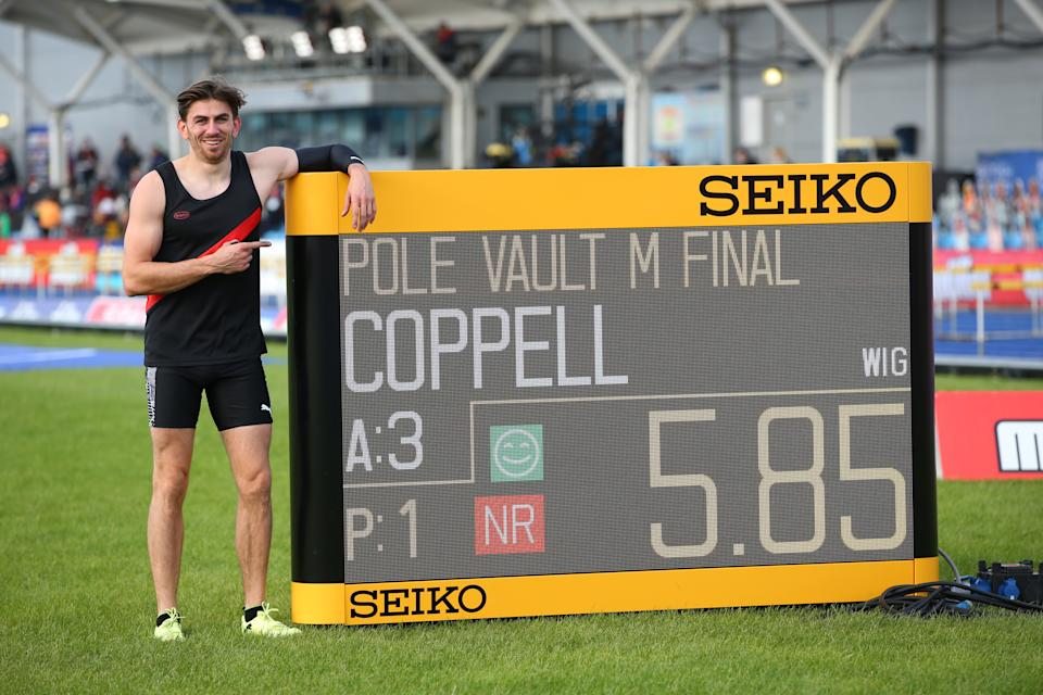 MANCHESTER, ENGLAND - SEPTEMBER 04: In this handout image provided by British Athletics, Harry Coppell of Great Britain poses next to the LED board which is displaying his new national record following his jump in the Men's Pole Vault during day one of Muller British Athletics Championships at Manchester Regional Arena on September 04, 2020 in Manchester, England.  (Photo by British Athletics - Handout/British Athletics via Getty Images)