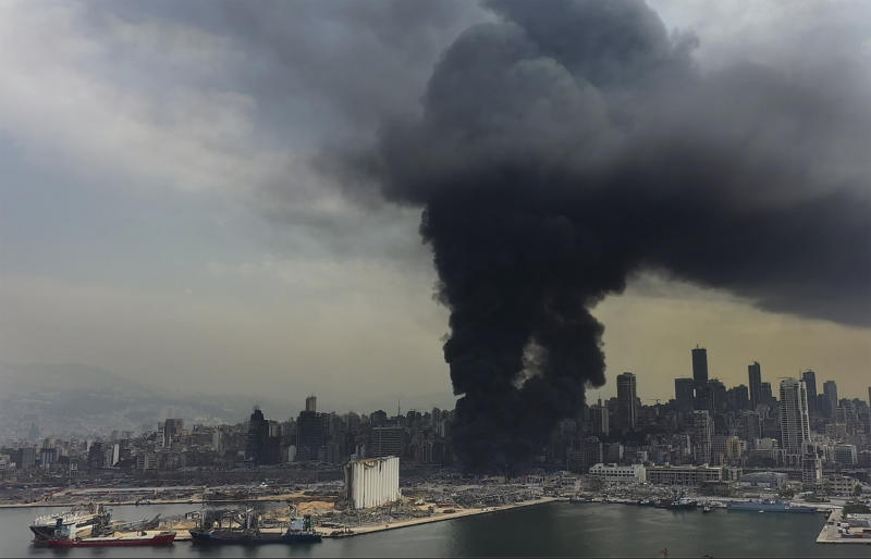 Black smoke rise from a fire at warehouses at the seaport of Beirut, Lebanon, Thursday, Sept. 10. 2020. A huge fire broke out Thursday at the Port of Beirut, triggering panic among residents traumatized by last month's massive explosion that killed and injured thousands of people. (AP Photo/Hussein Malla)