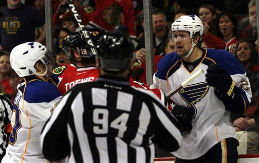 St. Louis Blues' Patrik Berglund, right, mixes it up with Chicago Blackhawks' Jonathan Toews (19) during the first period of an NHL hockey game on Sunday, Feb. 19, 2012, in Chicago. (AP Photo/John Smierciak)