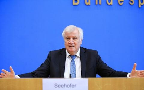 <span>Interior Minister Horst Seehofer said the bill was 'a vital contribution for successful integration' but others disagree</span> <span>Credit: Abdulhamid Hosbas/Anadolu Agency via Getty Images </span>