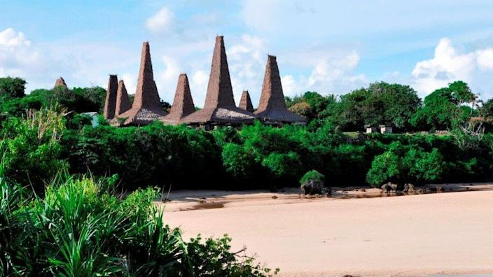 A traditional Sumba village made up of peaked houses.