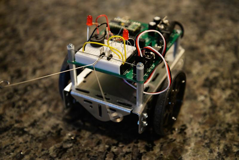 The Parallax Boe-Bot Robot Kit is shown in Decatur, Ga. on Dec. 16, 2013. The programmable robot must be built from scratch and uses tactile feelers and infrared technology to sense object in its path (AP Photo/ Ron Harris)