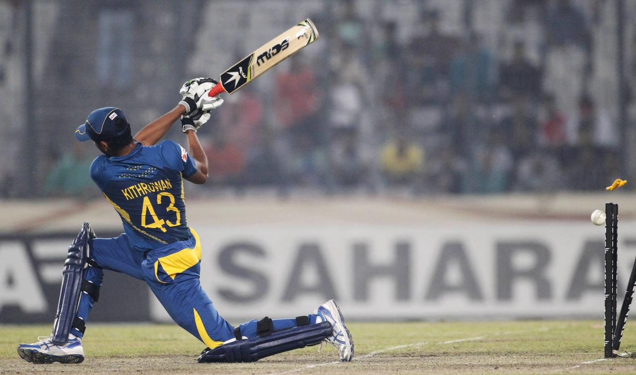 Sri Lanka's Kithuruwan Vithanage is bowled out against Bangladesh during their third one day international (ODI) cricket match of the series in Dhaka February 22, 2014. REUTERS/Andrew Biraj (BANGLADESH - Tags: SPORT CRICKET TPX IMAGES OF THE DAY)