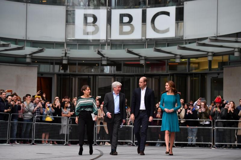 FILE PHOTO: Britain's Prince William, and Catherine, Duchess of Cambridge, walk with Director-General of the BBC Tony Hall and Director of BBC Children's Alice Webb as they visit BBC Broadcasting House in London
