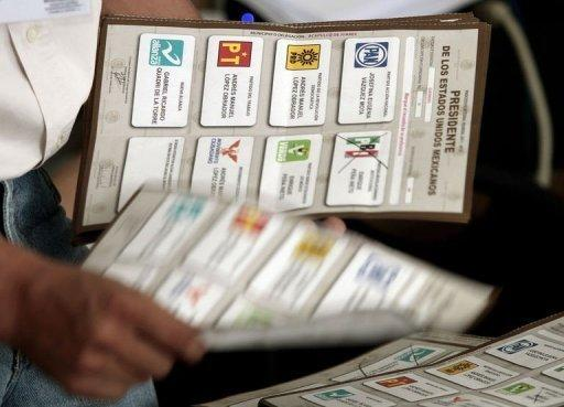An employee of the Federal Electoral Institute (IFE) counts votes in Acapulco, Guerrero state, Mexico. Mexico's national election authority Wednesday announced a recount of ballots cast at more than half of the polling stations in the country's weekend presidential election in which Enrique Pena Nieto claimed victory