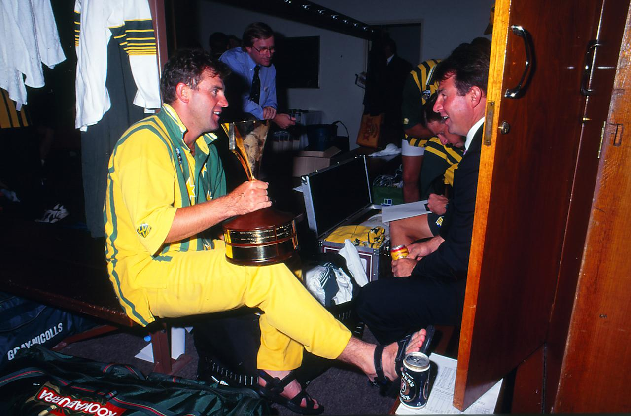 AUSTRALIA - JANUARY 17: Mark Taylor of Australia celebrates after a One Day International series win with the trophy on January 17, 1995 in Australia. (Photo by Getty Images)