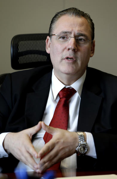 In this picture taken on Friday May 10, 2013, Syrian economist Abdullah al-Dardari, a chief economist at the Beirut-based U.N. Economic and Social Commission for Western Asia (ESCWA) and a former deputy prime minister in President Bashar Assad's government, speaks during an interview with the Associated Press, In Beirut, Lebanon. Al-Dardari tells The Associated Press in a rare interview that his six-member expert team has been overwhelmed with requests for the reconstruction plan to support the Kerry-Lavrov initiative on the off chance it would succeed. A group of economists led by one of Syria's top reformists are feverishly drawing up a comprehensive post-war reconstruction plan, even as the country's civil war rages on with no apparent end in sight. (AP Photo/Hussein Malla)