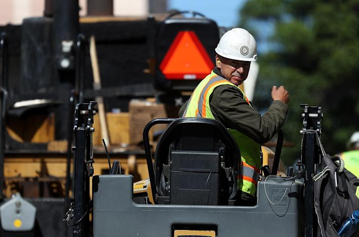 A construction worker operates a steam roller while paving a road on October 5, 2018 in San Francisco, California. (Photo: Justin Sullivan/Getty Images)