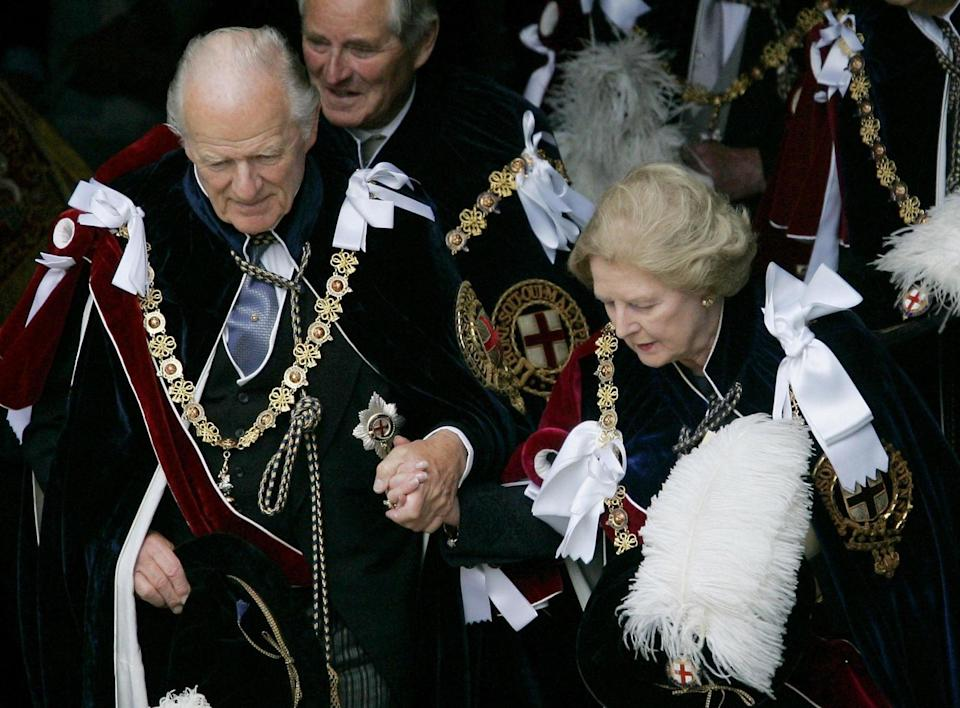 In 2005 with Baroness Thatcher during the Order of the Garter ceremony at Windsor - PA Images/Alamy