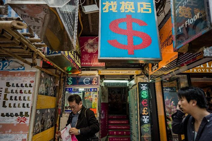 Many currency exchange shops in Hong Kong facilitate transferring money from wealthy Chinese overseas (AFP Photo/Philippe Lopez)