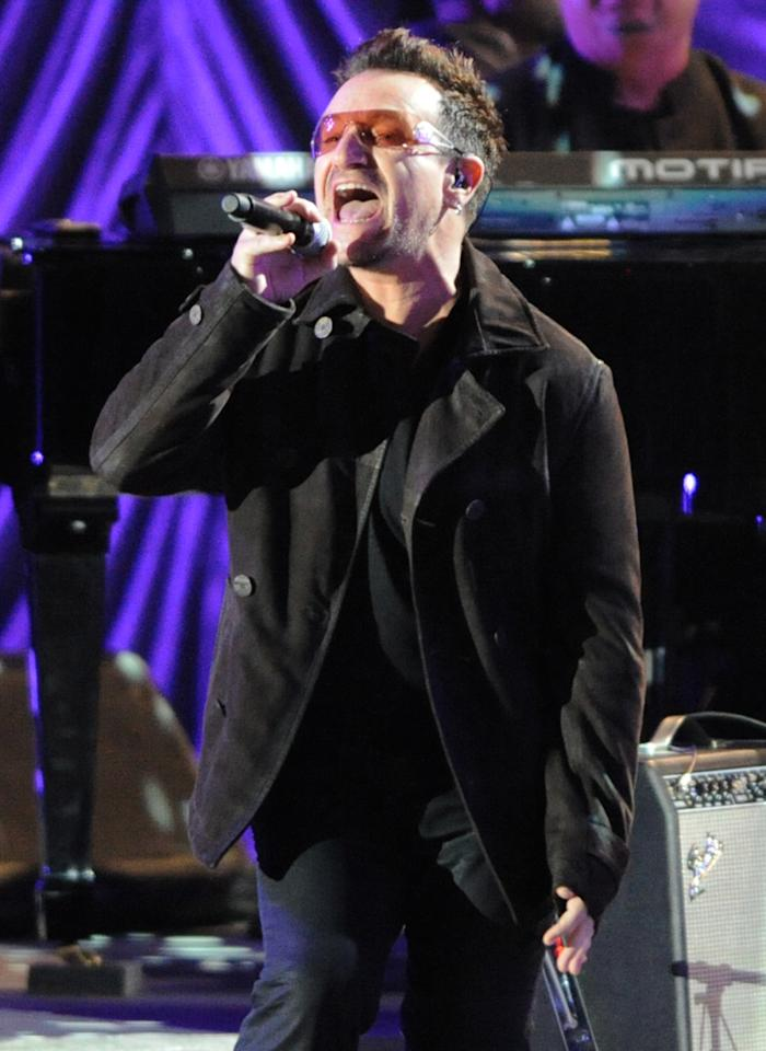 """Bono performs with K'naan at the """"A Decade of Difference"""" concert on October 15, 2011, at the Hollywood Bowl, Los Angeles. <br><br>(Photo by Stephanie Cabral/Yahoo!)"""
