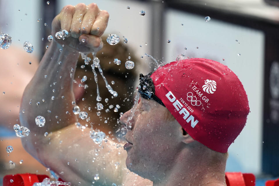 Tom Dean of Britain celebrates after winning the final of the men's 200-meter freestyle at the 2020 Summer Olympics, Tuesday, July 27, 2021, in Tokyo, Japan. (AP Photo/Martin Meissner)