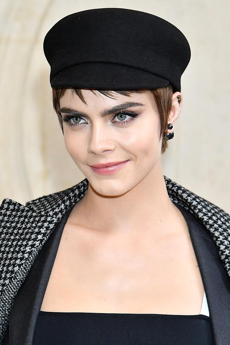 Cara Delevingne's bold brows were on full display at the Christian Dior during Paris Fashion Week Womenswear Fall/Winter 2018/2019. (Photo: Dominique Charriau/WireImage)