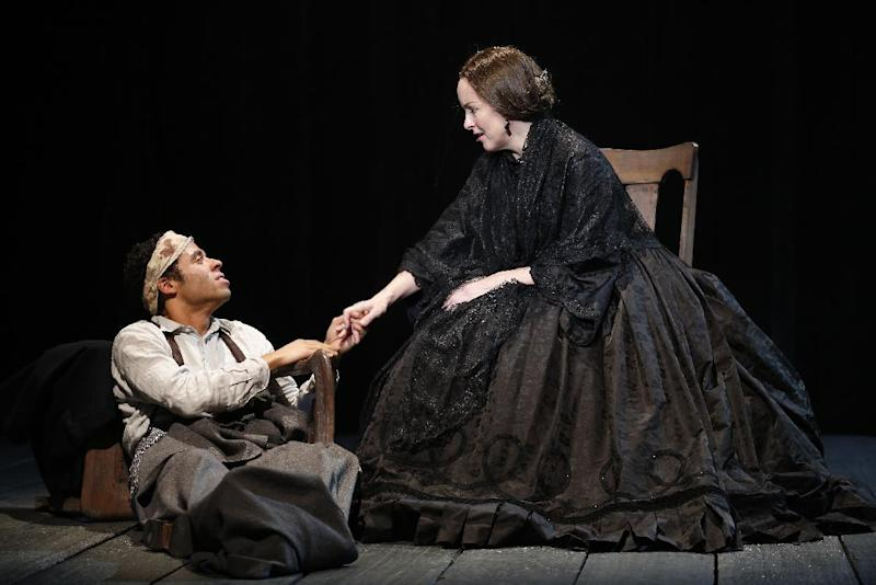 "In this undated publicity photo released by Richard Kornberg & Associates, Jonathan-David, left, and Alice Ripley perform in Paula Vogel's ""A Civil War Christmas,"" off-Broadway at New York Theatre Workshop in New York.  (AP Photo/Richard Kornberg  & Associates, Carol Rosegg)"