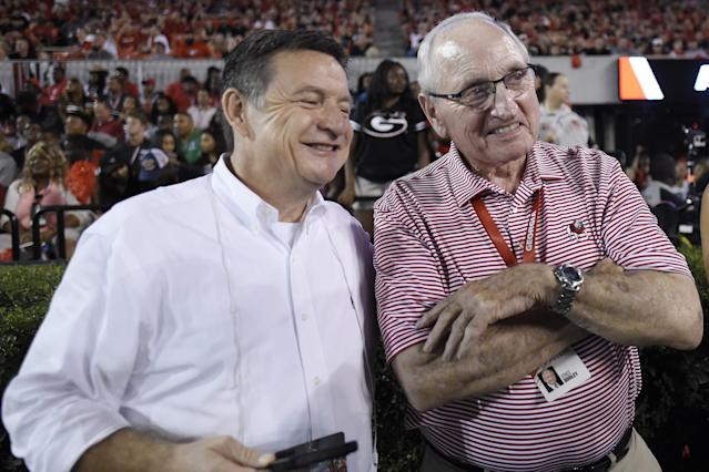 Former Georgia head coach and Athletic Director Vince Dooley, right, poses with a fan during the second of an NCAA college football game, Saturday, Sept. 23, 2017, in Athens, Ga. Georgia won 31-3. (AP Photo/Mike Stewart)