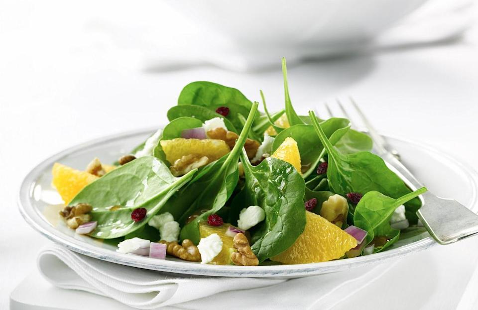 """<p>Finishing a bag of spinach isn't easy, but this recipe will do the trick and fill your day with tons of flavor. Tangerine slices and dried cranberries brighten the dish with their citrusy sweetness while the vinaigrette adds a punch of acidity.</p> <p><a href=""""https://www.thedailymeal.com/recipes/spinach-salad-tangerine-rosemary-vinaigrette-recipe?referrer=yahoo&category=beauty_food&include_utm=1&utm_medium=referral&utm_source=yahoo&utm_campaign=feed"""" rel=""""nofollow noopener"""" target=""""_blank"""" data-ylk=""""slk:For the Spinach Salad With Tangerine-Rosemary Vinaigrette recipe, click here."""" class=""""link rapid-noclick-resp"""">For the Spinach Salad With Tangerine-Rosemary Vinaigrette recipe, click here.</a></p>"""