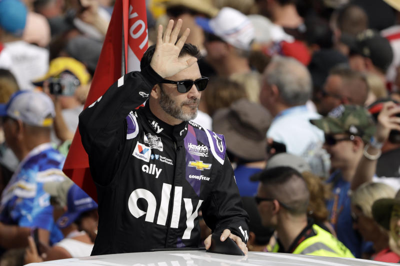 Jimmie Johnson waves to fans during driver introductions before the NASCAR Daytona 500 auto race Sunday, Feb. 16, 2020, at Daytona International Speedway in Daytona Beach, Fla. Johnson is making his last Daytona 500 start. (AP Photo/Chris O'Meara)