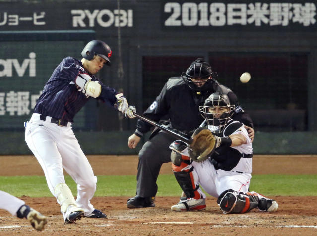All Japan's Shogo Akiyama hits an inside-the-park home run off MLB All-Star pitcher Collin McHugh of the Houston Astros in the eighth inning of Game 4 at their All-Stars Series baseball at Mazda Zoom-Zoom Stadium in Hiroshima, western Japan, Tuesday, Nov. 13, 2018. The catcher is J.T. Realmuto of the Miami Marlins. (Kyodo News via AP)