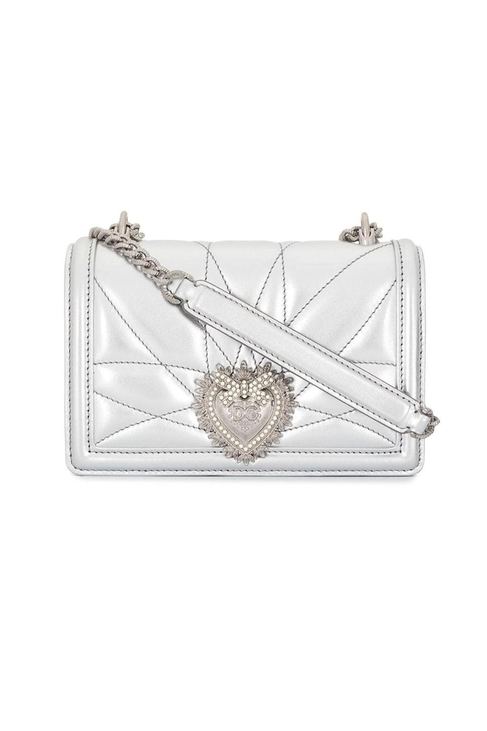 """<p><strong>Dolce & Gabbana</strong></p><p>farfetch.com</p><p><strong>$1945.00</strong></p><p><a href=""""https://go.redirectingat.com?id=74968X1596630&url=https%3A%2F%2Fwww.farfetch.com%2Fshopping%2Fwomen%2Fdolce-gabbana-devotion-metallic-shoulder-bag-item-15621631.aspx&sref=https%3A%2F%2Fwww.townandcountrymag.com%2Fstyle%2Ffashion-trends%2Fg36544376%2Fbest-metallic-accessories%2F"""" rel=""""nofollow noopener"""" target=""""_blank"""" data-ylk=""""slk:Shop Now"""" class=""""link rapid-noclick-resp"""">Shop Now</a></p><p>Why wear your heart on your sleeve when you can wear it on your Dolce & Gabbana purse? This is an instant closet staple. </p>"""