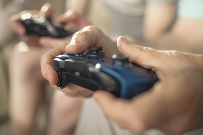 The must-have accessories and games, according to gaming experts. (Photo: Getty Images)