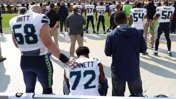 PHOTO: Seattle Seahawks' Michael Bennett remains seated on the bench during the national anthem before an NFL football game against the Green Bay Packers Sunday, Sept. 10, 2017, in Green Bay, Wis. (Jeffrey Phelps/AP)