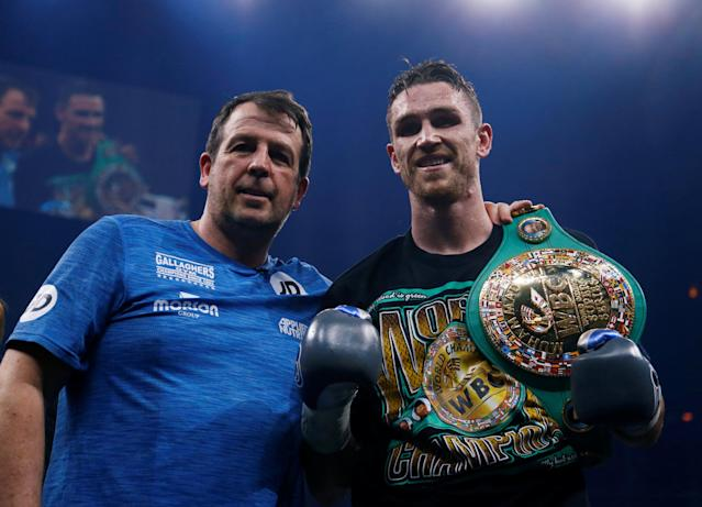 Boxing - World Boxing Super Series Semi Final - Callum Smith vs Nieky Holzken - Arena Nurnberger Versicherung, Nuremberg, Germany - February 24, 2018 Callum Smith celebrates with trainer Joe Gallagher after winning the fight REUTERS/Ralph Orlowski