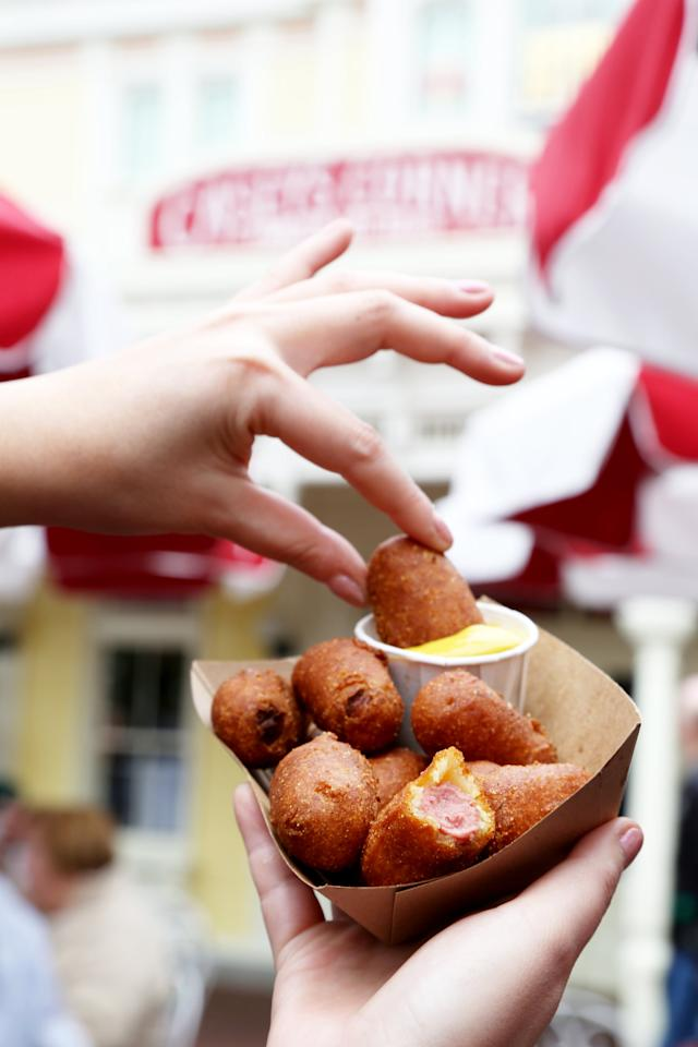 """<p>These corn dog nuggets are legendary, and they do not disappoint. These fried morsels have a smoky, sweet flavor that pairs really well with tart yellow mustard.  </p> <p><strong>Where to find it:</strong> <a href=""""https://disneyworld.disney.go.com/dining/magic-kingdom/caseys-corner/"""" target=""""_blank"""" class=""""ga-track"""" data-ga-category=""""Related"""" data-ga-label=""""https://disneyworld.disney.go.com/dining/magic-kingdom/caseys-corner/"""" data-ga-action=""""In-Line Links"""">Casey's Corner</a> on Main Street at Magic Kingdom</p>"""