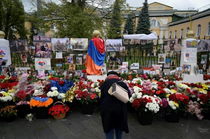 A woman visits a makeshift memorial outside the Armenian embassy in Moscow for Armenians killed during the conflict over the breakaway region of Nagorno-Karabakh