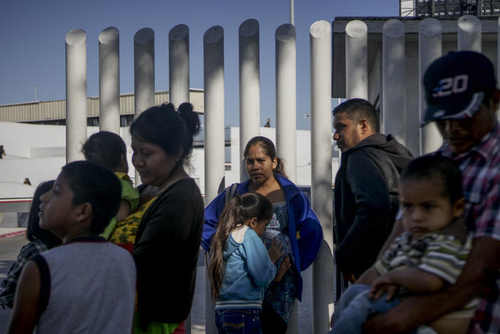 Migrants from Honduras wait in line at the U.S.-Mexico border crossing in Tijuana, Mexico, Sept. 12, 2019. (Photo: Sandy Huffaker/AFP via Getty Images)
