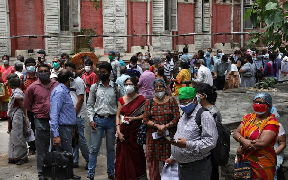 People wait to receive their second dose of COVISHIELD, vaccine manufactured by Serum Institute of India, in Kolkata - Reuters