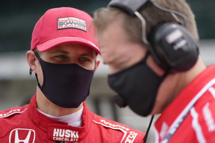Marcus Ericsson, of Sweden, talks with a crew member during practice for the Indianapolis 500 auto race at Indianapolis Motor Speedway, Wednesday, May 19, 2021, in Indianapolis. (AP Photo/Darron Cummings)