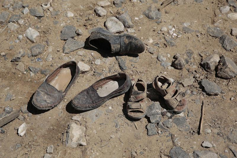Shoes of victims lay on the ground at the site of a house destroyed by a Saudi-led airstrikes in outskirts of Sanaa, Yemen, Thursday, Feb. 16, 2017. At least one Saudi-led airstrike near Yemen's rebel-held capital killed at least five people on Wednesday, the country's Houthi rebels and medical officials said. (AP Photo/Hani Mohammed)