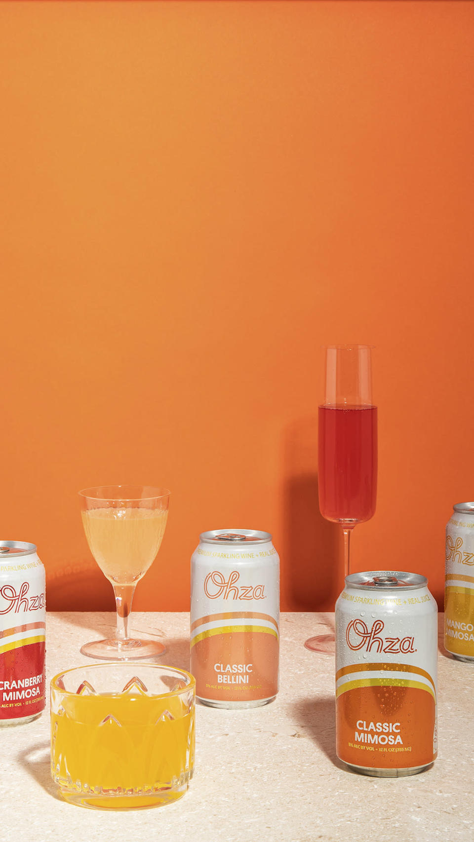 """<p>Toast all the inspiring ladies in your life with these yummy single-serve drinks. The <a href=""""https://ohzamimosas.com/"""" rel=""""nofollow noopener"""" target=""""_blank"""" data-ylk=""""slk:champagne cocktail"""" class=""""link rapid-noclick-resp"""">champagne cocktail</a> comes in four scrumptious and refreshing flavors including Mimosa and Bellini — they're perfect for brunch!</p> <p><strong>$39 for 12 cans, <a href=""""https://ohzamimosas.com/"""" rel=""""nofollow noopener"""" target=""""_blank"""" data-ylk=""""slk:ohzamimosas.com"""" class=""""link rapid-noclick-resp"""">ohzamimosas.com</a></strong></p>"""