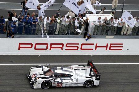 FILE PHOTO - Nico Hulkenberg of Germany celebrates with mechanics after winning with his Porsche 919 Hybrid number 19 the Le Mans 24-hour sportscar race in Le Mans, central France, June 14, 2015. REUTERS/Regis Duvignau