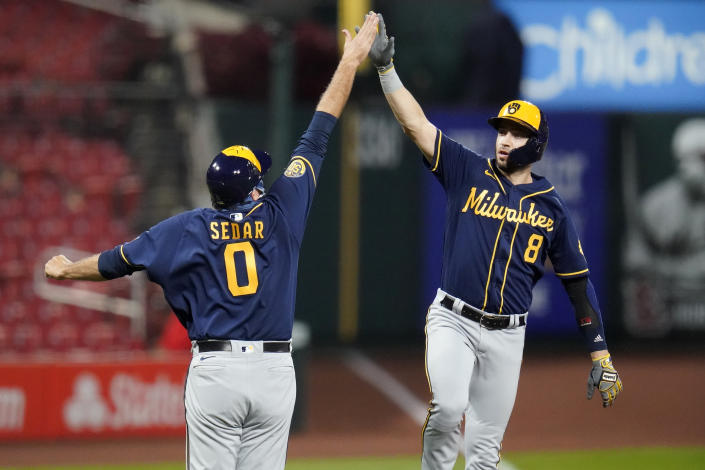 Milwaukee Brewers' Ryan Braun (8) is congratulated by third base coach Ed Sedar after hitting a solo home run during the fourth inning of a baseball game against the St. Louis Cardinals Saturday, Sept. 26, 2020, in St. Louis. (AP Photo/Jeff Roberson)