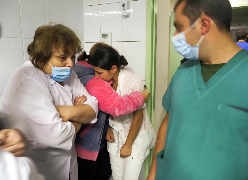 Medical workers reacts hiding in a basement of a hospital during shelling by Azerbaijan's artillery in Stepanakert, the separatist region of Nagorno-Karabakh, Wednesday, Oct. 28, 2020. Nagorno-Karabakh officials said Azerbaijani forces hit Stepanakert, the region's capital, and the nearby town of Shushi with the Smerch long-range multiple rocket systems, killing one civilian and wounding two more. (AP Photo)